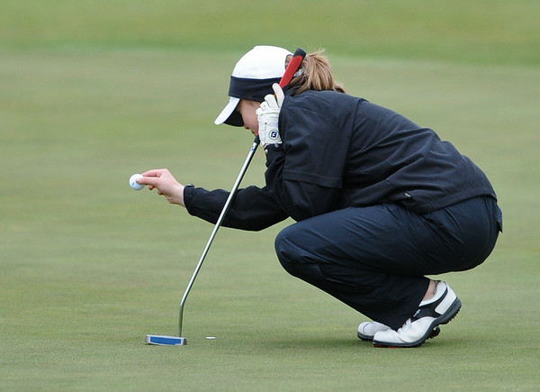 GOLF08<br /> Danielle Mercure of Skyline lines up a putt at a state qualifier meet at Longmont's Ute Creek Golf Course on Tuesday.<br /> Photo by Marty Caivano/Camera/May 11, 2010