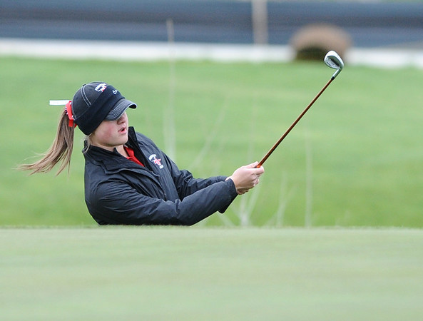 GOLF02<br /> Fairview's Amy Carlson chips onto the green at a state qualifier meet at Longmont's Ute Creek Golf Course on Tuesday.<br /> Photo by Marty Caivano/Camera/May 11, 2010