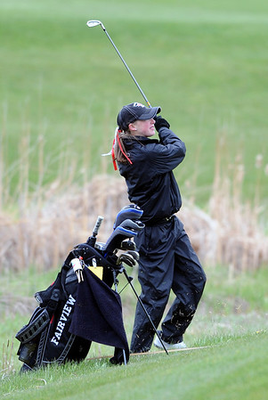 GOLF01<br /> Fairview's Jordan Sunset chips onto the green at a state qualifier meet at Longmont's Ute Creek Golf Course on Tuesday.<br /> Photo by Marty Caivano/Camera/May 11, 2010