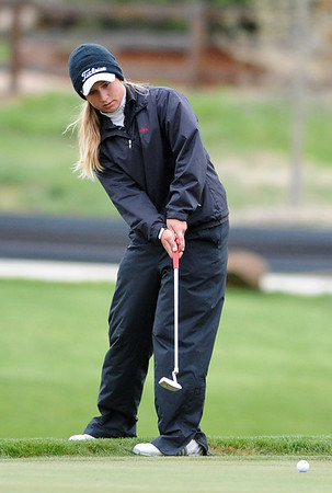 GOLF05<br /> Skyline's Mikayla Tatman putts on the 10th hole at a state qualifier meet at Longmont's Ute Creek Golf Course on Tuesday.<br /> Photo by Marty Caivano/Camera/May 11, 2010