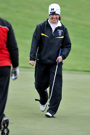 GOLF10<br /> Boulder's Kalina Grabb reacts after sinking a putt on the final hole at a state qualifier meet at Longmont's Ute Creek Golf Course on Tuesday.<br /> Photo by Marty Caivano/Camera/May 11, 2010