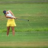 NorthWood senior Abigail Richner hits an iron shot on the first hole Tuesday in an NLC contest between the Panthers and Concord at Bent Oak Golf Club in Elkhart.