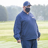 Fairfield Falcons head coach Dennis Schooley observes his players during the Goshen Girls Golf Invitational Monday morning at Black Squirrel Golf Club in Goshen.