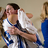Record-Eagle/Jan-Michael Stump<br /> Lake Leelanau St. Mary Allison Korson (12) hugs Steffanie Priest (44) as she leaves the game near the end of Tuesday's loss to Johannesburg-Lewiston.