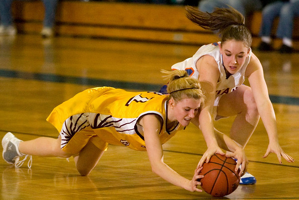 Record-Eagle/Jan-Michael Stump<br /> Arenac Eastern's Danielle Jurek (41) and Central Lake's Heidi Hicks (2) fight for a loose ball in the second quarter of Tuesday's game.