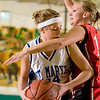 Record-Eagle/Jan-Michael Stump<br /> Lake Leelanau St. Mary's Brooke Fortner (34) tries to get past Johannesburg-Lewiston's Jessica Sewell (14) in the first quarter of Tuesday's game.