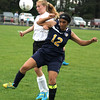Record-Eagle/James Cook Northport's Manmeet Dhami (12) and Kingsley's Hannah Dutton (23) vie for the ball in Friday's game at Kingsley.