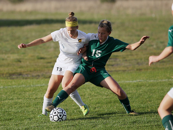 Record-Eagle/Keith King<br /> Traverse City Central's Cari Rice, left, and Traverse City West's Eva Brunetti battle for the ball Tuesday, May 8, 2012 at the Coast Guard fields in Traverse City.