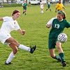 Record-Eagle/Keith King<br /> Traverse City Central's Sophie Lutz, left, kicks the ball away from Traverse City West's Mikenna Ray Tuesday, May 8, 2012 at the Coast Guard fields in Traverse City.