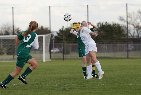Record-Eagle/Keith King<br /> Traverse City Central's Alyssa Zick heads the ball against Traverse City West Tuesday, May 8, 2012 at the Coast Guard fields in Traverse City.