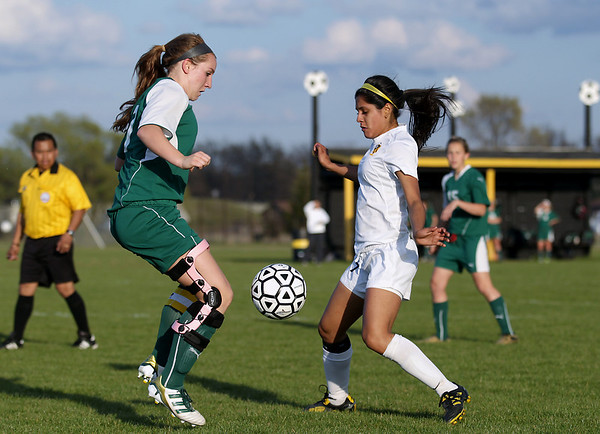 Record-Eagle/Keith King<br /> Traverse City West's Jessica Kalbfleisch, left, and Traverse City Central's Jalyna Cisneros look to control the ball Tuesday, May 8, 2012 at the Coast Guard fields in Traverse City.