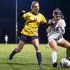 Northridge Raiders junior Olivia Adkins (14) battles for the ball against Warsaw Tigers defender Jordan Love (12) Thursday during the game at Todd Woodworth Field in Middlebury.