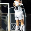 Warsaw Tigers defender Jordan Love (12) hugs her teammate midfielder Zoe Bergan (25) after scoring a goal Thursday during the game at Todd Woodworth Field in Middlebury.