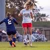 Westview Warriors midfielder Katie Engelage (15) dribbles the ball across the pitch against Lakeland Christian Academy Cougars junior Julia Jartzler (2) during Tuesdays game at Elkhart Christian Academy in Elkhart.