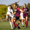 Bethany Christian Bruins midfielder Zoe Williams (11) battles for the ball Central Noble Cougars defender Naomi Leffers (14) during Tuesdays game at Elkhart Christian Academy in Elkhart.