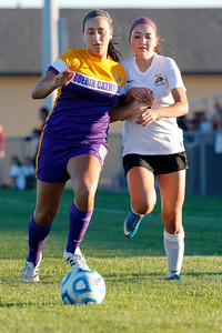 Avon High School junior Wren Weyenberg (3) battles with Guerin Catholic junior Adele Stradling for control of the ball during the match between Guerin Catholic and Avon  at Avon High School in Avon,IN. (Jeff Brown/Flyer Photo)