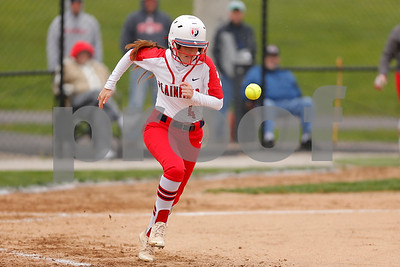 Plainfield High School outfielder Taylor Dykins  (4) heads to first on the infield single during the game between Martinsville vs Plainfield at  Plainfield  High School in Plainfield,IN. (Jeff Brown/Flyer Photo)
