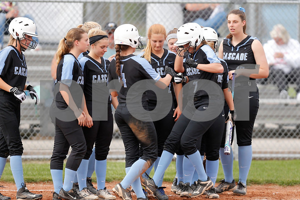 Cascade High School pitcher Alisha Burch (7) is greeted by her team mates after hitting a two run home run during the game between South Putnam vs Cascade at Cascade High School in Clayton,IN. (Jeff Brown/Flyer Photo)
