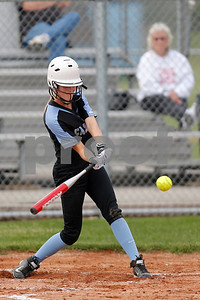 Cascade High School outfielder Hannah Decker (11) connects for a single during the game between South Putnam vs Cascade at Cascade High School in Clayton,IN. (Jeff Brown/Flyer Photo)