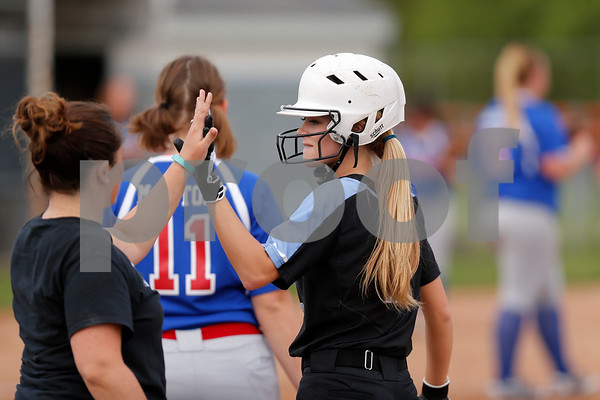 Cascade High School outfielder Hannah Decker (11) gets a high five from her fist base coach after connecting for a single during the game between South Putnam vs Cascade at Cascade High School in Clayton,IN. (Jeff Brown/Flyer Photo)
