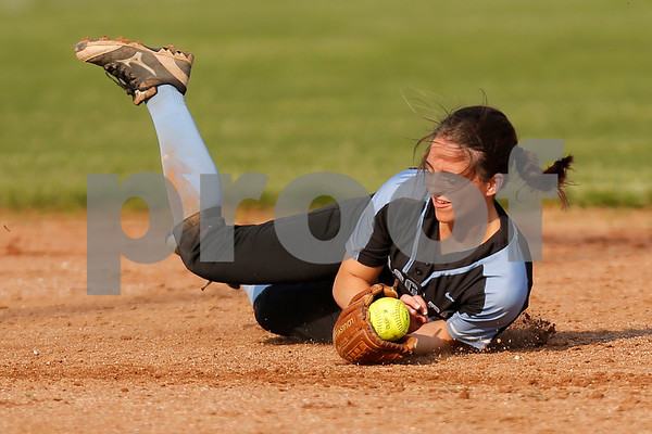 Cascade High School shortstop Makayla Collier (4) makes a nice diving catch to end the inning during the game between South Putnam vs Cascade at Cascade High School in Clayton,IN. (Jeff Brown/Flyer Photo)