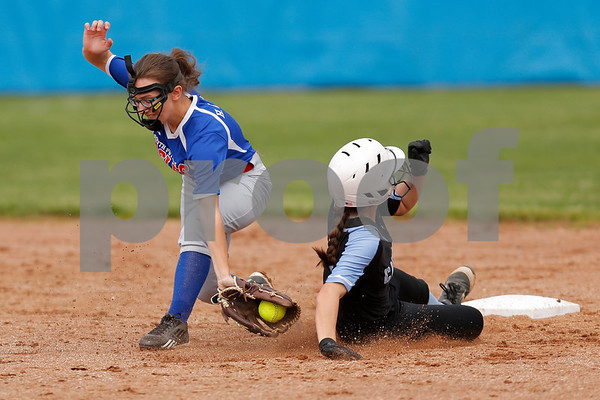 Cascade High School shortstop Makayla Collier (4) slides safely into second ahead of the tag by South Putnam High School shortstop Helen Eaglin (1) during the game between South Putnam vs Cascade at Cascade High School in Clayton,IN. (Jeff Brown/Flyer Photo)