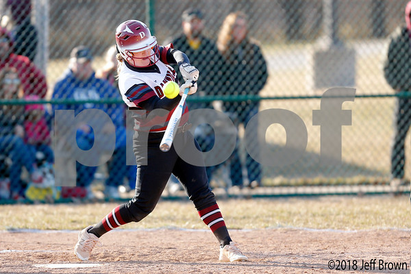 Danville Warrior sophomore Delanie Joines (19) connects for a single down the right field line during the  game between the Southmont Mounties and Danville Warriors at Danville High School in Danville,IN. (Jeff Brown/Flyer Photo)