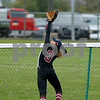 Danville High School sophomore Kate Barton (3) reaches for the fly ball but it was just out of reach during the game between Tri-West vs Danville at  Danville High School in Danville,IN. (Jeff Brown/Flyer Photo)