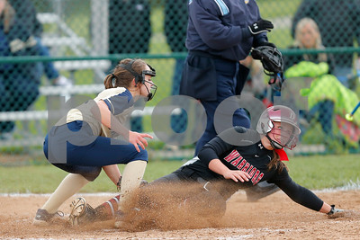 Danville High School senior Kaiti Skinner (13) slides safely under the tag of Tri-West High School pitcher Hannah Forrest (4) during the game between Tri-West vs Danville at  Danville High School in Danville,IN. (Jeff Brown/Flyer Photo)