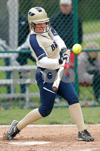 Tri-West High School catcher Morgan Forrest (12) launches a double during the game between Tri-West vs Danville at  Danville High School in Danville,IN. (Jeff Brown/Flyer Photo)