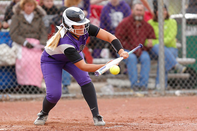 Brownsburg high school shortstop Kyleigh Anderson (20) lays down the sacrifice bunt during the game between Zionsville vs Brownsburg at  Brownsburg High School in Brownsburg,IN. (Jeff Brown/Flyer Photo)