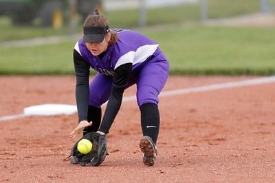 Brownsburg high school third baseman Cecilia Ridgeway (C) (5) fields the ground ball during the game between Zionsville vs Brownsburg at  Brownsburg High School in Brownsburg,IN. (Jeff Brown/Flyer Photo)