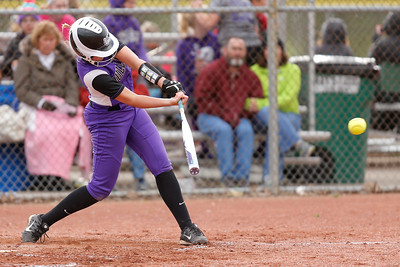 Brownsburg high school infielder Anna Carroll (C) (2) connects for a single during the game between Zionsville vs Brownsburg at  Brownsburg High School in Brownsburg,IN. (Jeff Brown/Flyer Photo)