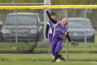 Brownsburg high school center fielder Mackenzie Bedrick (21) fires the ball back into the infield during the game between Zionsville vs Brownsburg at  Brownsburg High School in Brownsburg,IN. (Jeff Brown/Flyer Photo)