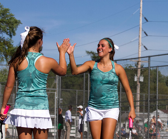 SAM HOUSEHOLDER | THE GOSHEN NEWS<br /> Northridge No. 1 doubles players Courtney Clark, right and Emily Erekson high five during their match Wednesday at Elkhart Central High School.