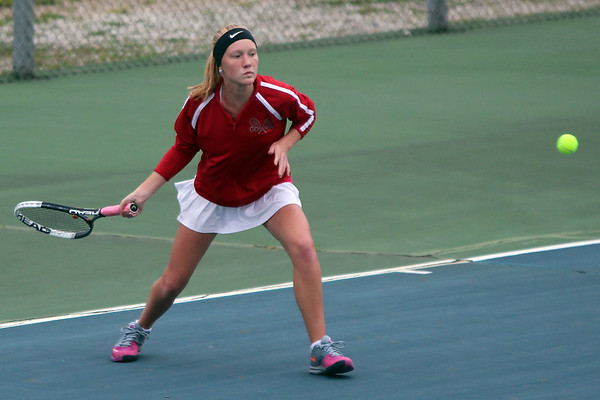 STEPHEN BROOKS | THE GOSHEN NEWS<br /> Goshen senior Ali Miller prepares to hit a forehand in the No. 1 doubles match of Tuesday's home meet against NorthWood. NorthWood won 4-1.