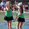 STEPHEN BROOKS | THE GOSHEN NEWS<br /> Concord doubles players Emma Westlake, left, and Maya Klopfenstein, right, high-five during the No. 1 doubles flight of Tuesday's match at Northridge. Concord won 3-2.