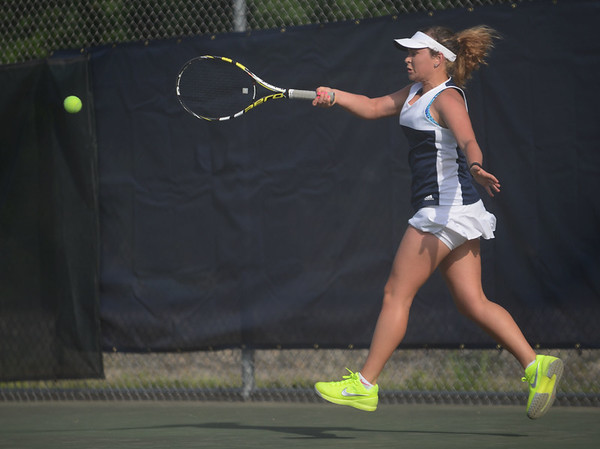 HALEY WARD | THE GOSHEN NEWS<br /> Fairfield No.1 singles player Emily Mast hits a forehand in the Regional Championship match against Elkhart Memorial on Wednesday at Elkhart Central High School. Mast lost 6-7, 6-7 in the 2-3 Fairfield loss.