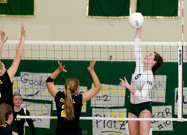 Record-Eagle/Keith King<br /> Traverse City West's Hannah Pohlman hits the ball against Traverse City Central Wednesday, October 6, 2010 at Traverse City West Senior High School.