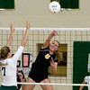 Record-Eagle/Keith King<br /> Traverse City Central's Brianna Podsaid, hits the ball as Traverse City West's Anna Arnold, left, jumps Wednesday, October 6, 2010 at Traverse City West Senior High School.