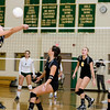 Record-Eagle/Keith King<br /> Traverse City Central's Nina Radakovich hits the ball against Traverse City West as teammates Brittney Bell, from right, Brianna Podsaid and Melina Bonaccini look on Wednesday, October 6, 2010 at Traverse City West Senior High School.