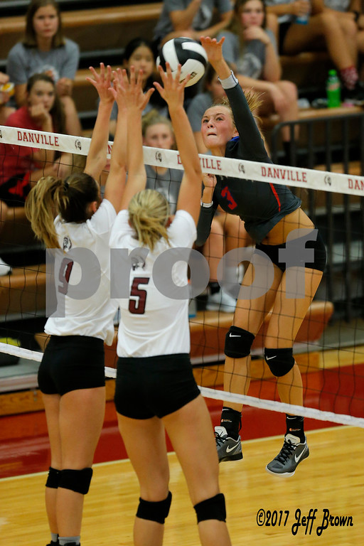 Plainfield High School sophomore Olivia Utterback (3) fires the shot into Danville High School junior Kiersten Johnson (9) and Danville High School senior Claudia Ellis (5) during the volleyball match between Plainfield vs Danville at Danville High School in Danville,IN. (Jeff Brown/Flyer Photo)