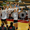 Plainfield High School sophomore Olivia Utterback (3) fires her shot past Danville High School senior Kyara Black (14) and Danville High School sophomore Callie Sharkey (7) during the volleyball match between Plainfield vs Danville at Danville High School in Danville,IN. (Jeff Brown/Flyer Photo)