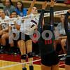 Danville High School junior Kiersten Johnson (9) fires her shot over Plainfield High School senior Erika Turpin (10) during the volleyball match between Plainfield vs Danville at Danville High School in Danville,IN. (Jeff Brown/Flyer Photo)