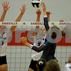 Danville High School senior Claudia Ellis (5) and Danville High School junior Kiersten Johnson (9) go for the block of Plainfield High School sophomore Olivia Utterback (3) shot during the volleyball match between Plainfield vs Danville at Danville High School in Danville,IN. (Jeff Brown/Flyer Photo)