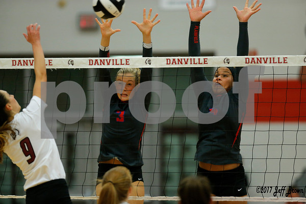 Plainfield High School sophomore Olivia Utterback (3) and Plainfield High School senior Kennedy Thomas (4) go up for the block of Danville High School junior Kiersten Johnson (9) shot during the volleyball match between Plainfield vs Danville at Danville High School in Danville,IN. (Jeff Brown/Flyer Photo)