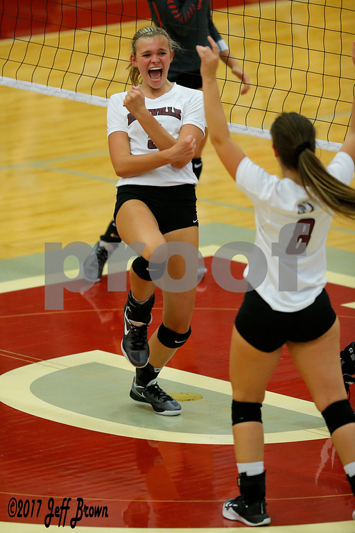 Danville High School senior Claudia Ellis (5) celebrates a point during the volleyball match between Plainfield vs Danville at Danville High School in Danville,IN. (Jeff Brown/Flyer Photo)