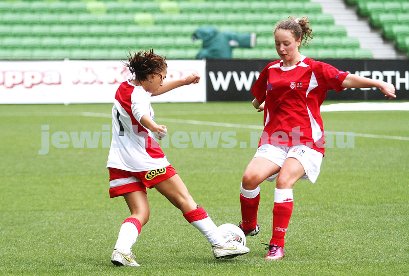 16-3-13. Girls with Heart soccer match. AAMI Park, Melbourne. xxxxxxx (right) going in to tackle. Photo: Peter Haskin