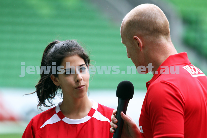 16-3-13. Girls with Heart soccer match. AAMI Park, Melbourne. Rebecca Rubinstein being interviewed pre match. Photo: Peter Haskin