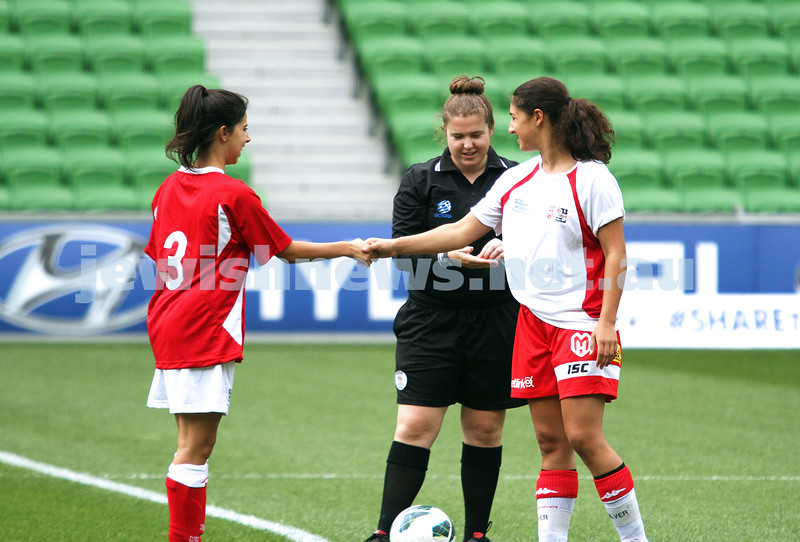 16-3-13. Girls with Heart soccer match. AAMI Park, Melbourne. Rebecca Rubinstein (left), shakes hands with Amy Silver. Photo: Peter Haskin
